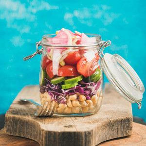Vegetable and chickpea sprout vegan salad in jar  square crop