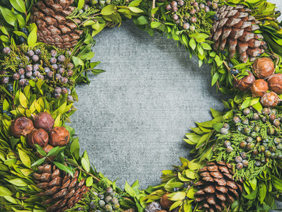 Christmas decorative wreath over concrete background  copy space