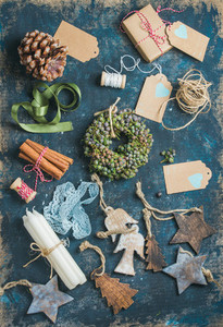 Christmas related objects on shabby table background  top view
