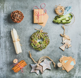 Christmas related objects on grey concrete table background  top view