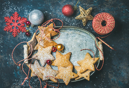 Christmas star shaped gingerbread cookies  decorative snowflakes  balls and toys