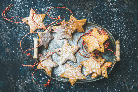 Christmas star shaped gingerbread cookies for tree decoration with ropes