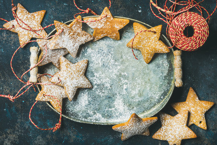 Christmas holiday star shaped gingerbread cookies in metal tray