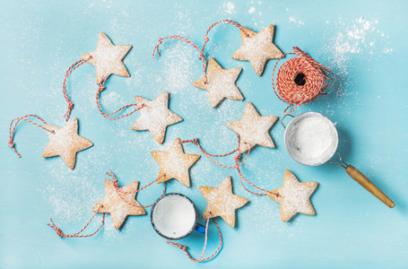 Christmas gingerbread cookies with sugar powder and decoration rope