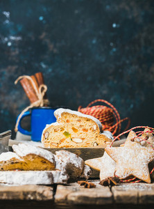 Traditional German Christmas cake Stollen with gingerbread cookies  copy space