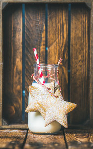 Bottle with milk and Christmas festive gingerbread star shaped cookies