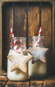 Bottles with milk for Santa and Christmas festive gingerbread cookies