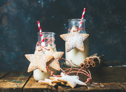 Bottles with milk Christmas festive cookies decoration rope spices