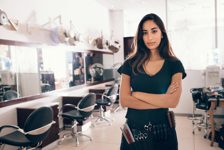 Portrait of female hairstylist looking at camera