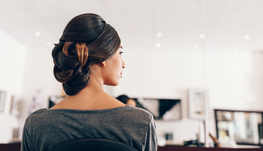 Woman in fashionable hairdo at a salon