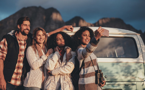 Friends on road trip taking selfie