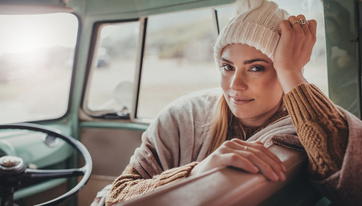Beautiful woman on roadtrip travelling by van