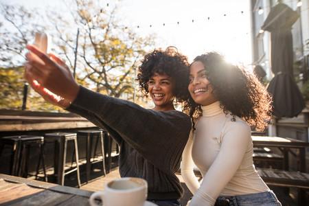 Two happy women having fun taking a selfie
