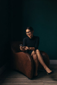 Sophisticated asian female using mobile phone