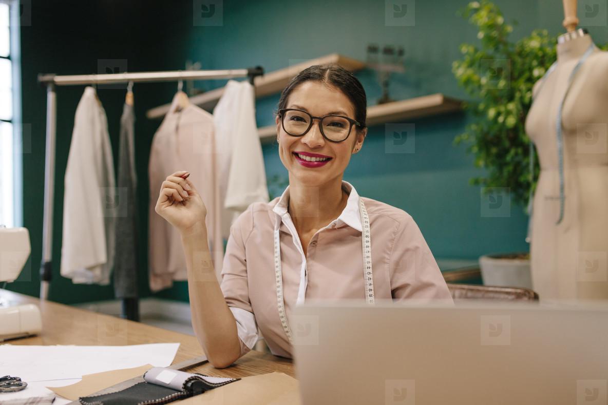 Asian woman working in a fashion studio