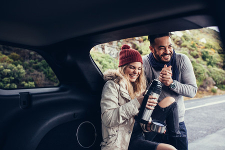 Couple having coffee break during road trip