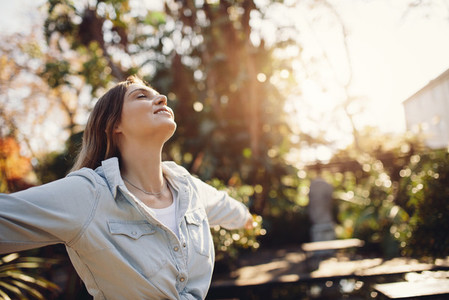 Woman at park enjoying fresh air