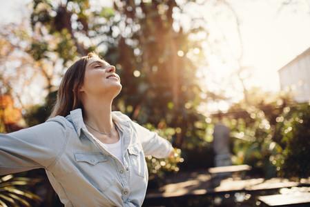 Woman at park enjoying fresh air