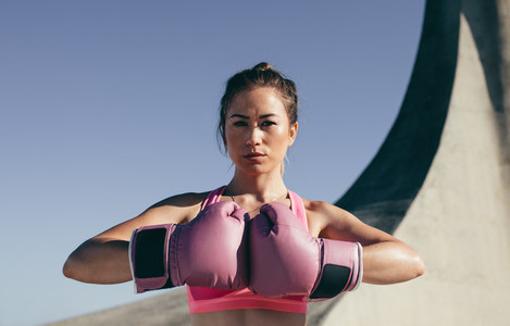Female boxer ready for practice outdoors