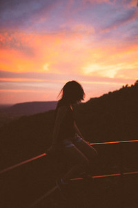 A girl enjoying sunset view