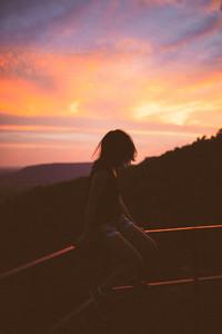 A girl enjoying sunset view