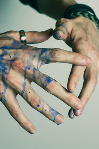 Young man039s hands with paint