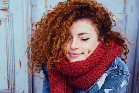 Young woman with a red scarf