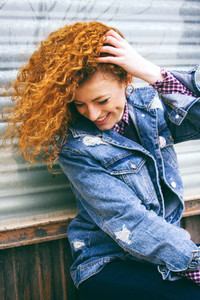 Cool and young redhead woman