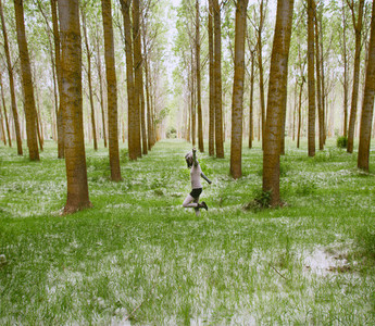 Young woman alone in forest