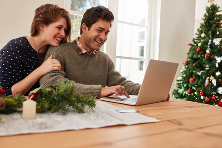 Couple buying christmas gifts online