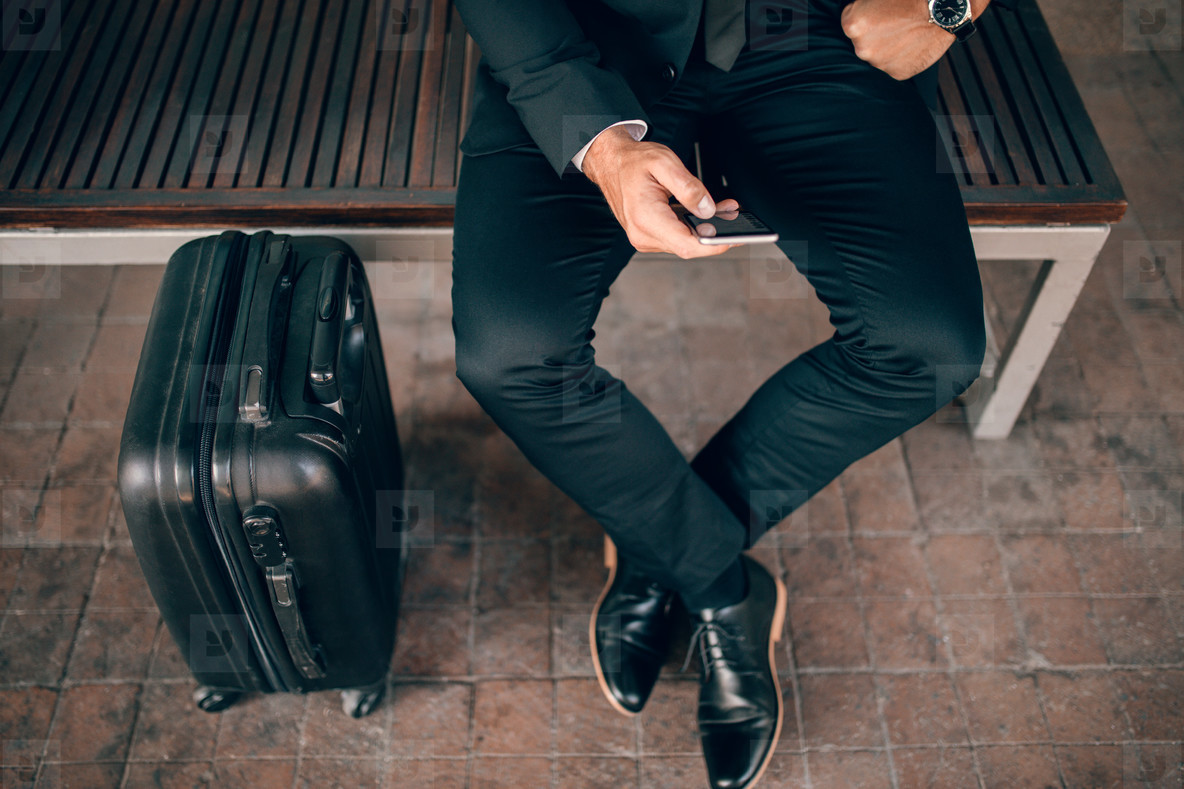Businessman waiting at public transportation station