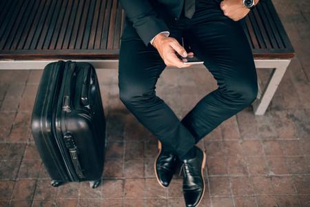 Businessman waiting at public transportation station