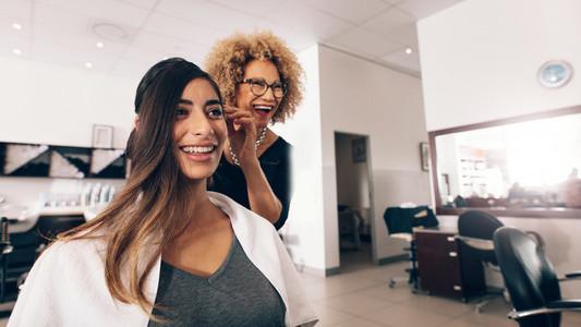 Woman hairdresser at work in salon