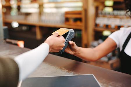 Customer paying bill using card