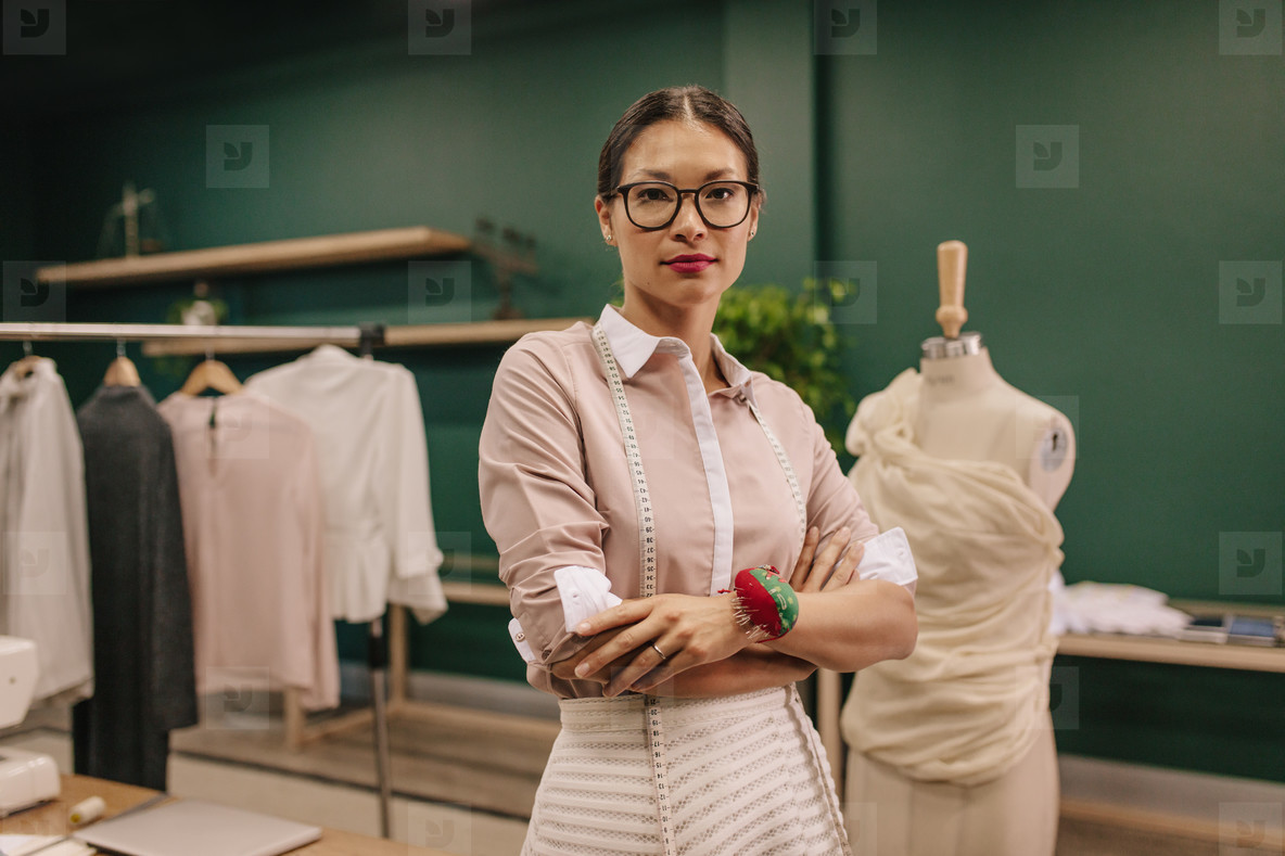 Fashion designer standing in her workshop