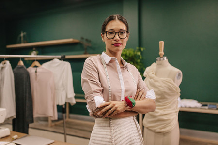 Fashion designer standing in her workshop