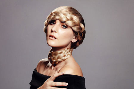 Sensual woman with creative braid hairdo