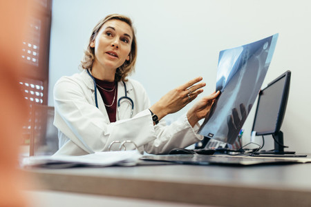Doctor explaining checkup result to her patient