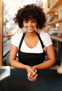 Portrait of female bartender in coffee shop