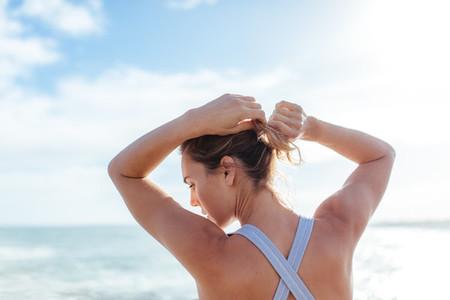 Female athlete tying hair outdoors