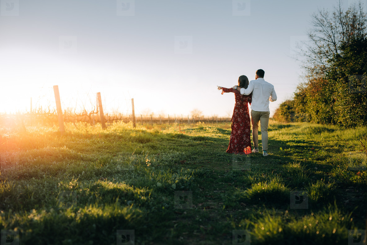 Young couple walking together at vineyard