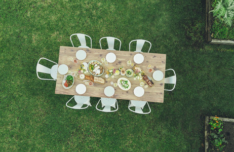Aerial view of garden restaurant table