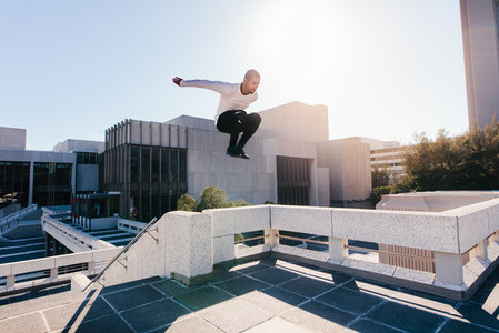 Man doing parkour tricking and freerunning
