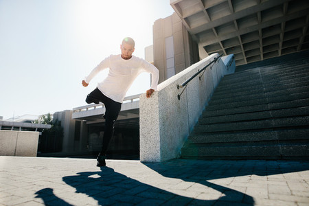 Fit urban guy performing a wall spin