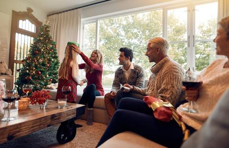 Family with little girl celebrating christmas festival at home