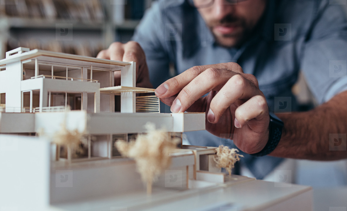 Architect hands making model house