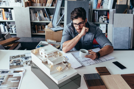 Young male architect taking break from work