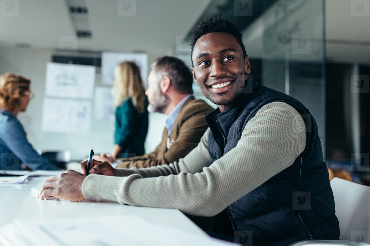 African man sitting in board room
