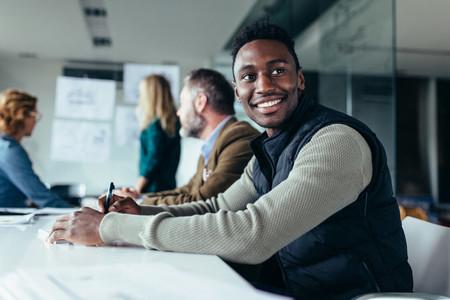African man sitting in board room