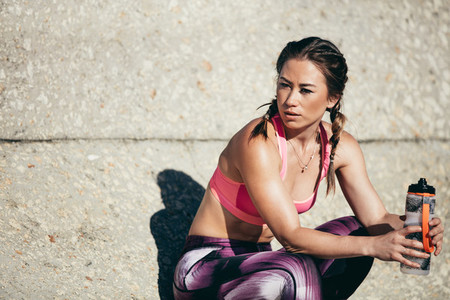 Fitness woman taking a break after healthy workout